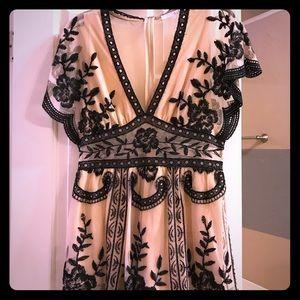 Beautiful lace/sheer romper